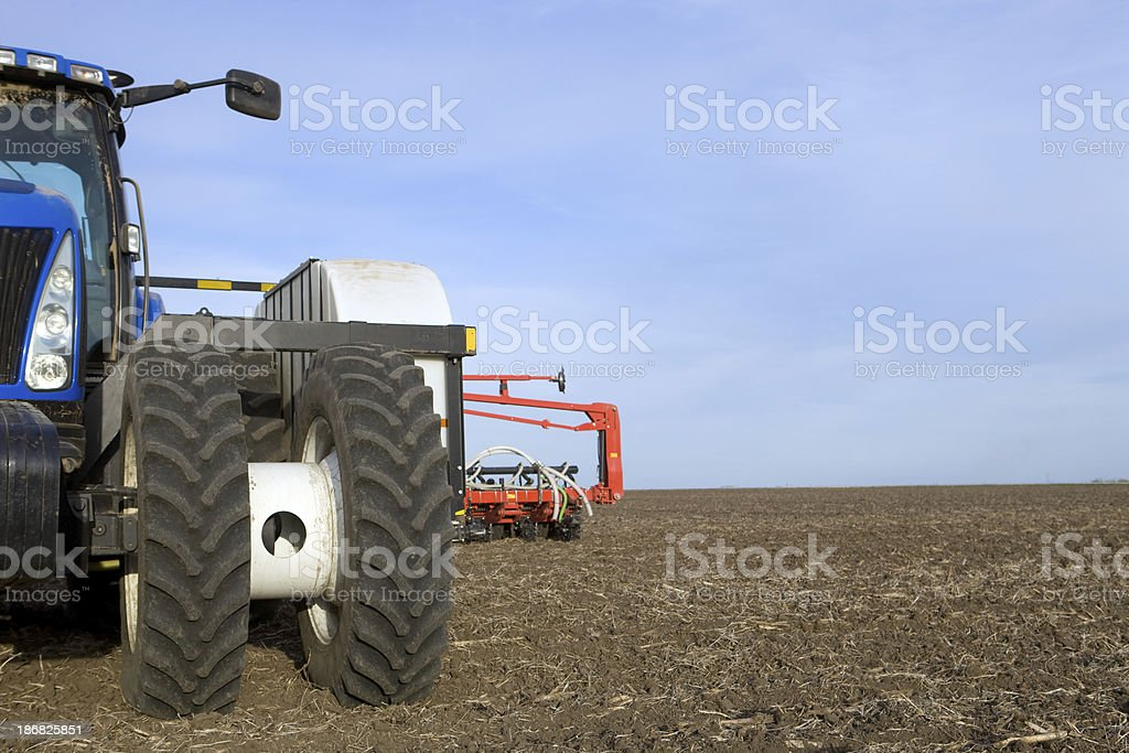 Large Tractor and Corn Planter on Tilled Field royalty-free stock photo