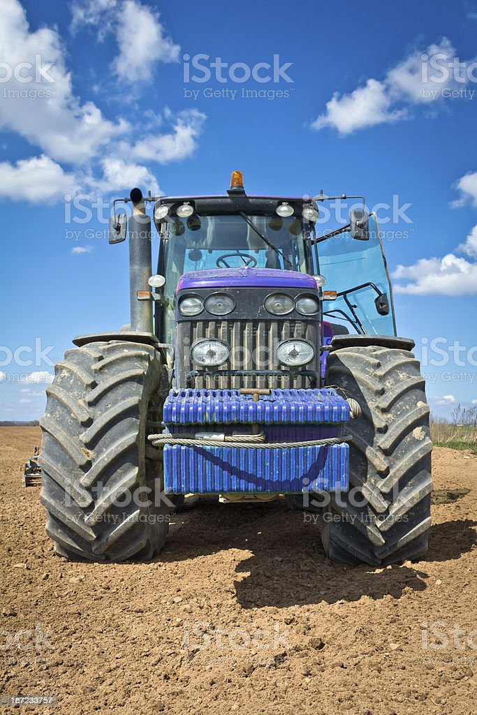 Large tractor plowing field royalty-free stock photo