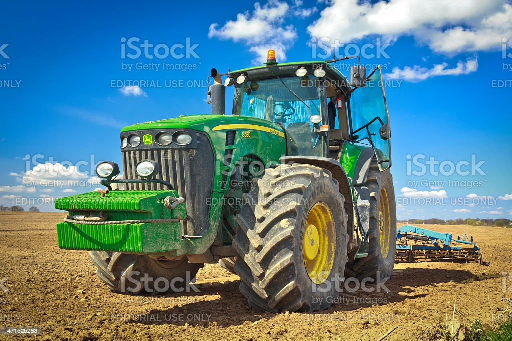 Large tractor plowing field stock photo