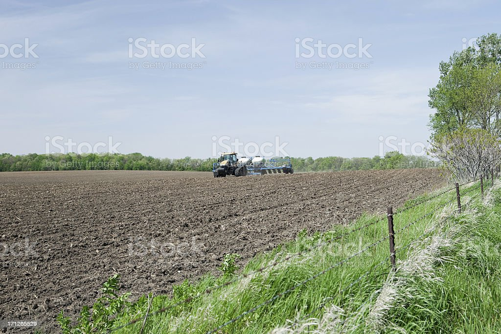 Large Tractor with Corn Planter in Field royalty-free stock photo