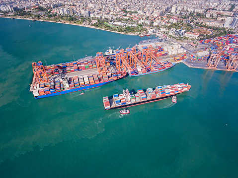 Large transport ship and view of the harbor. High angle view on Cargo crane container terminal