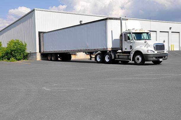 large truck and warehouse - lorries unloading stock photos and pictures