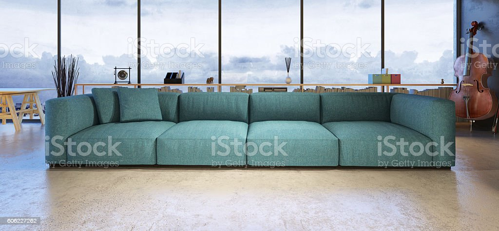Large turquoise sofa in a loft stock photo