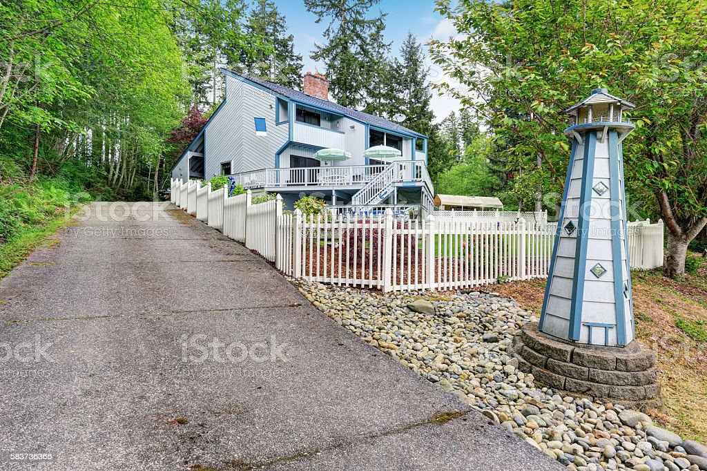 Large two story marine style home with long concrete driveway. stock photo