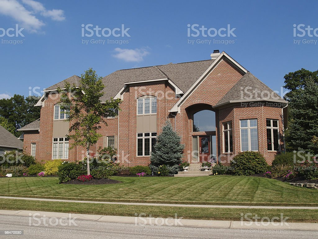 Large Two Story New Brick Home With Turret royalty-free stock photo