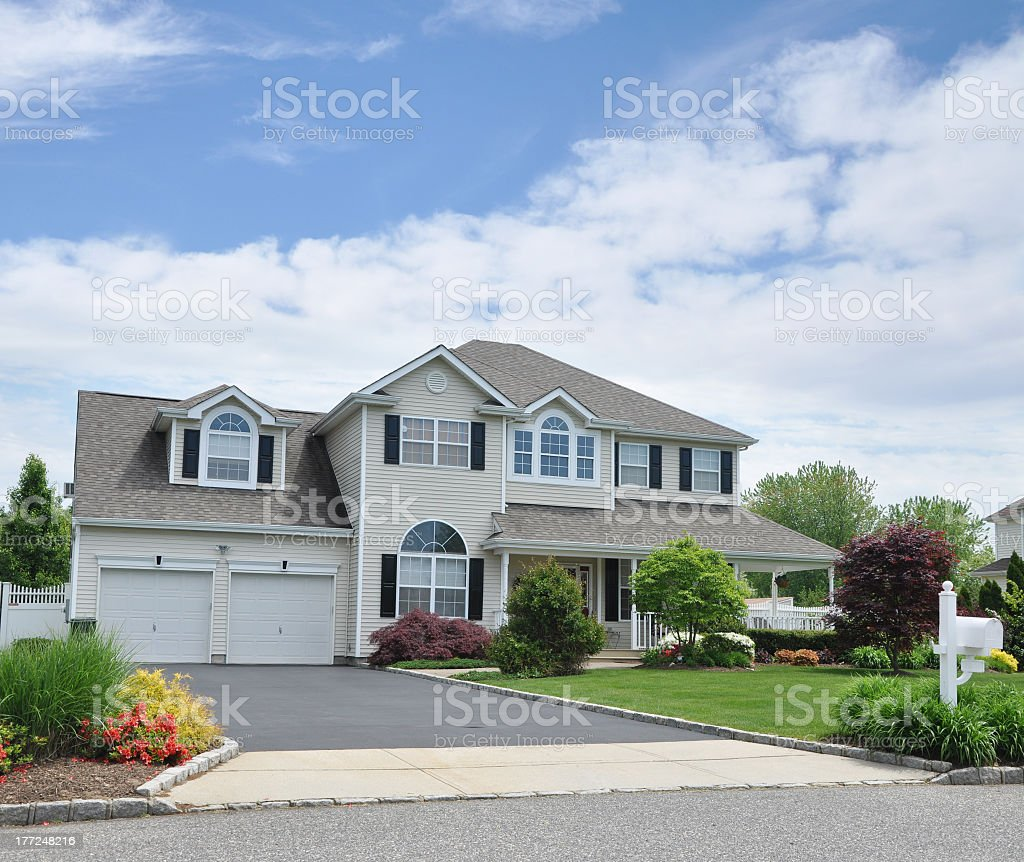 Large two story suburban home with wrap around porch stock photo