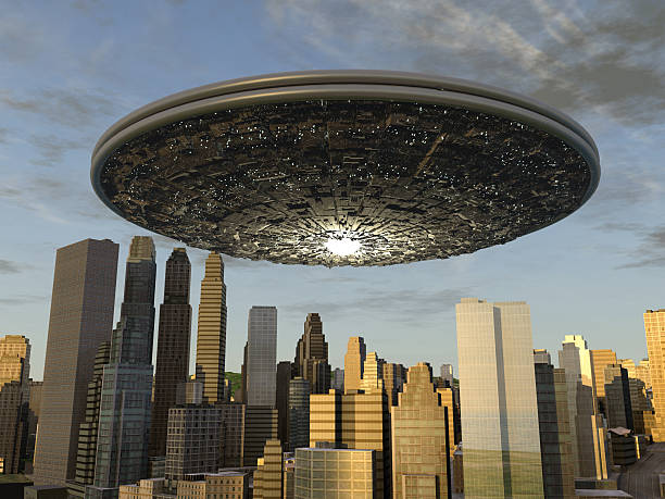 Large UFO over a city stock photo