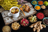 istock Large variety of multi colored dried tea leaves and flowers on the table. 1277145238