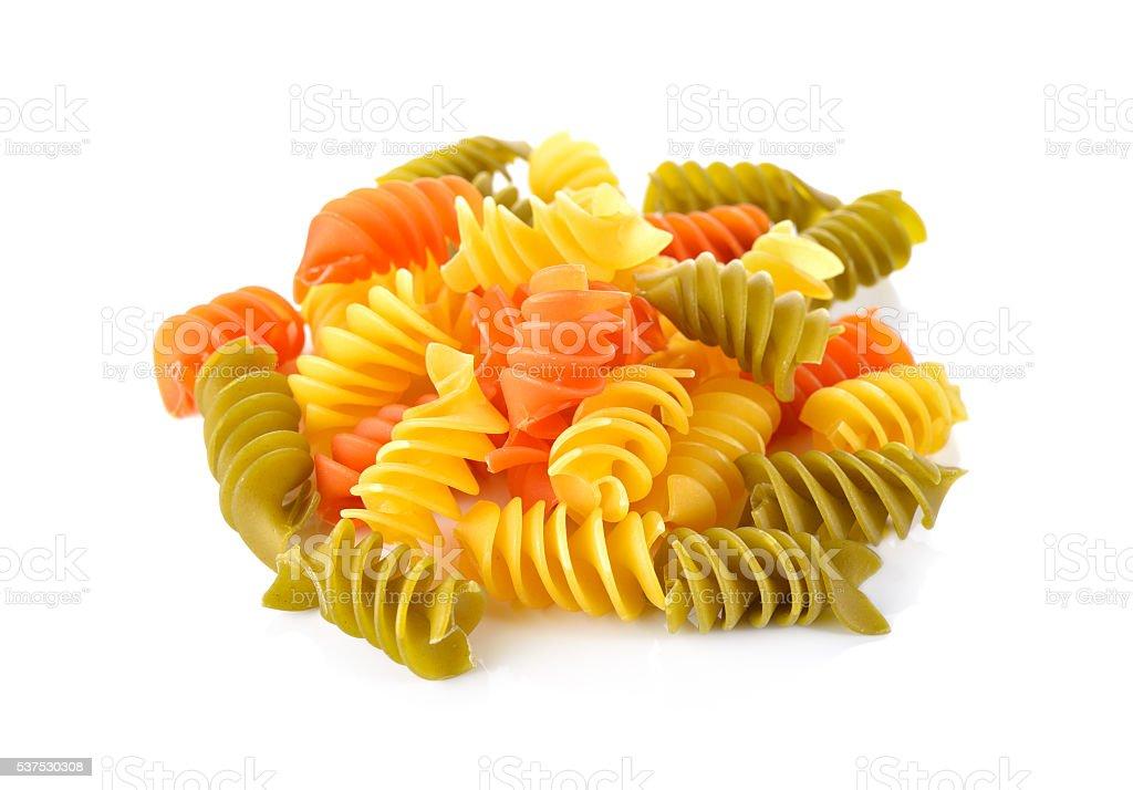 Large Vegeroni Rotini spilral pasta on white background stock photo