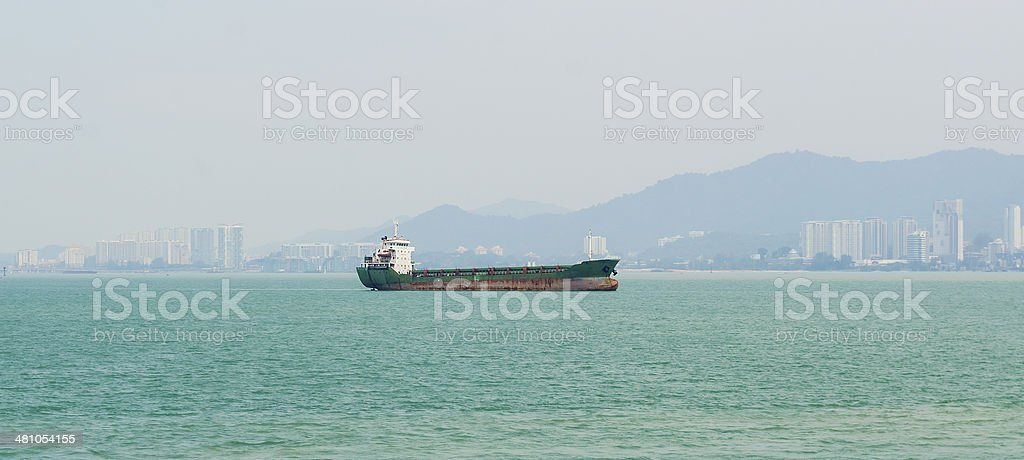 Large vessels carrying goods into the port. stock photo