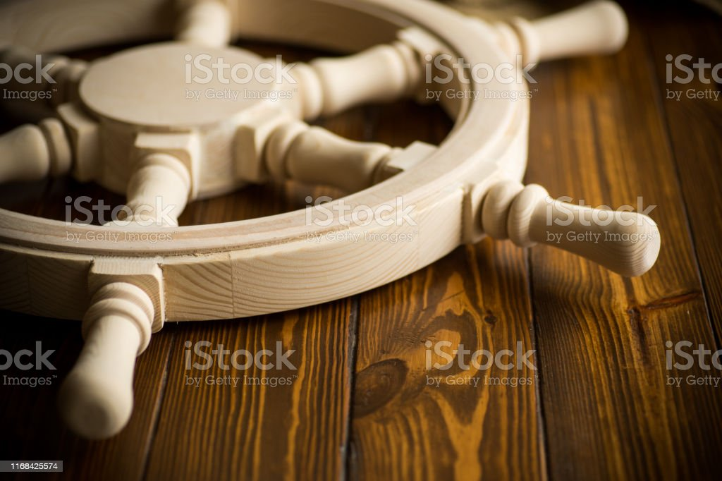 Large Vintage Steering Wheel On A Wooden Table Stock Photo Download Image Now Istock
