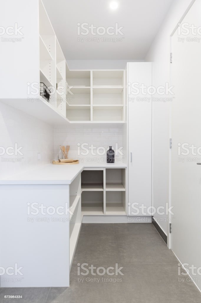 Large walk in butlers pantry storage area stock photo