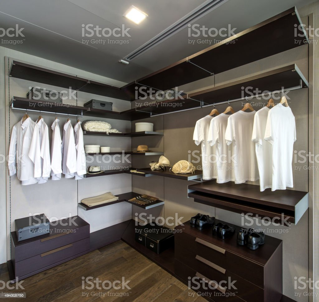 Large walk-in closet with shelves stock photo