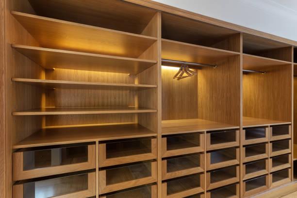 Large wardrobe closet, with empty shelves. stock photo