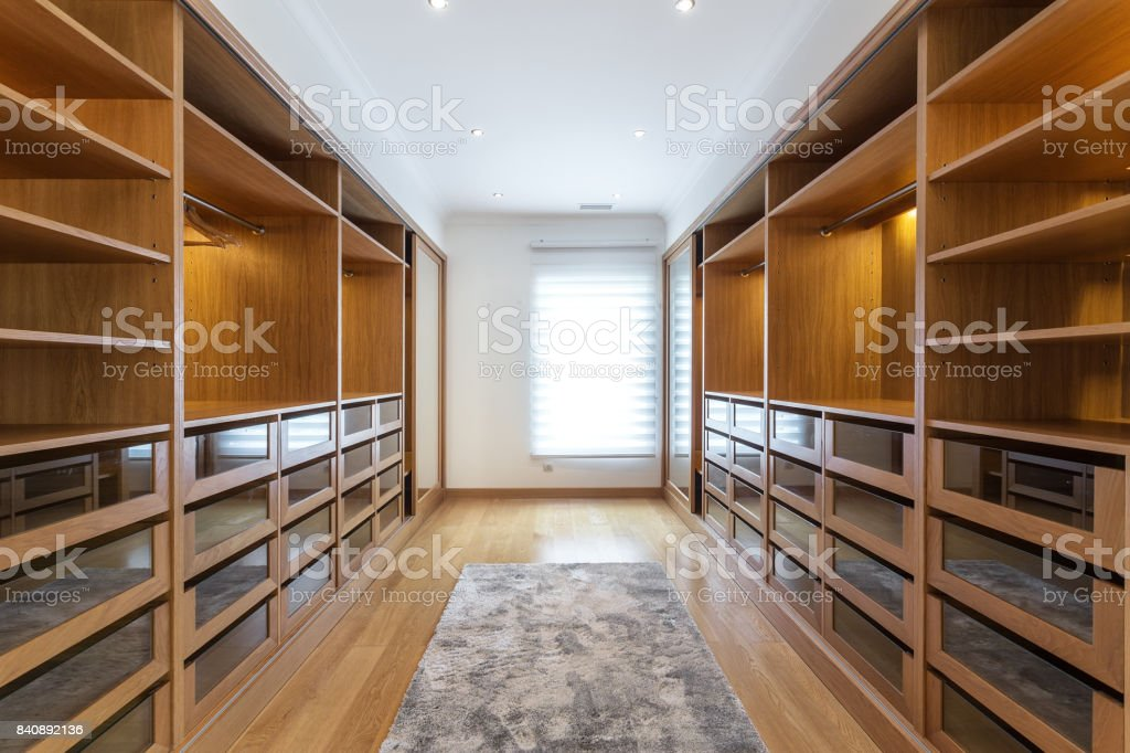 Large wardrobe room, with empty shelves. stock photo