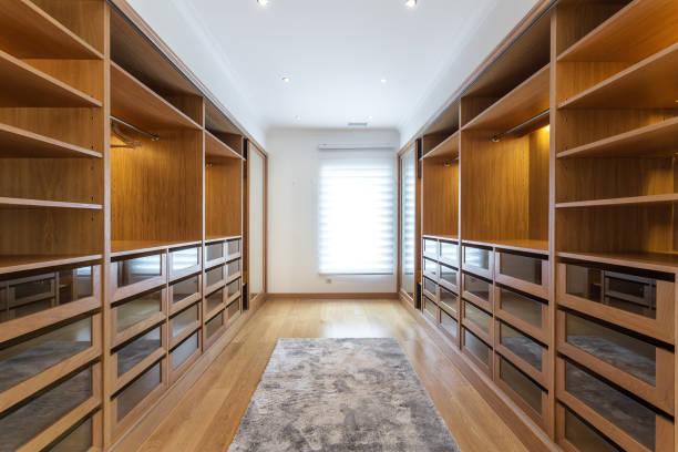 Large wardrobe room, with empty shelves. stock photo
