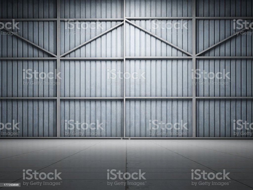 Large warehouse door illuminate stock photo