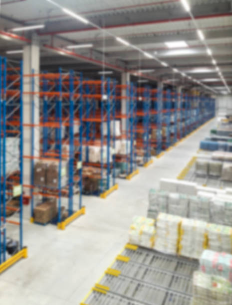 Large warehouse with tiered storage. Blured Large warehouse with tiered storage. Blured distribution center stock pictures, royalty-free photos & images