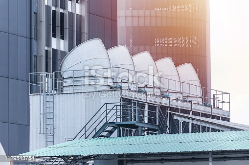 istock Large water chiller for air condition system on the building rooftop 1129543754