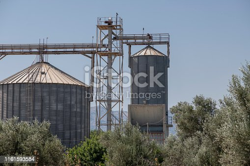 Large water towers on Greek Island of Chios. Shallow depth of field. Blurred background. The image was captured with a prime lens and a full frame DSLR camera at low ISO resulting in large clean files.