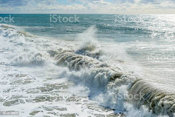 Photo of large wave breaking onshore from storm surge