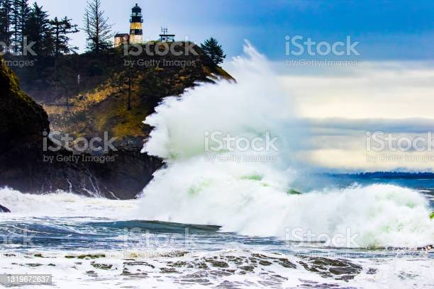 Photo of Large Wave Crashes Onshore at Cape Disappointment Lighthouse