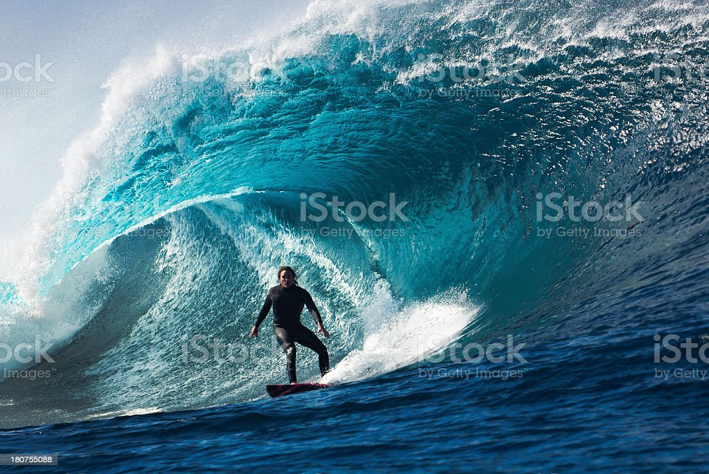 Large wave with surfer in tunnel wave stock photo