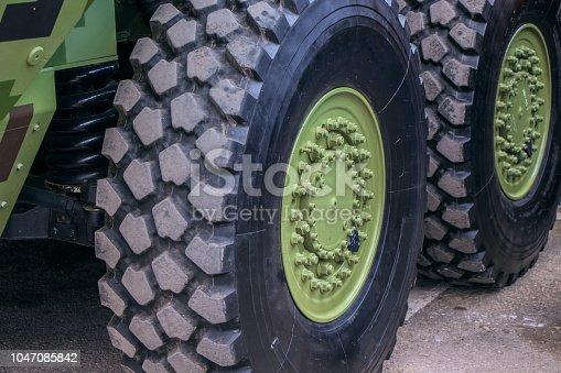 istock large wheels on military  vehicle. 1047085842