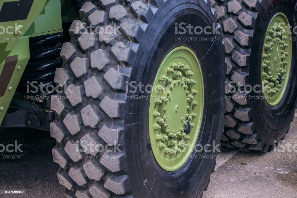 large wheels on military  vehicle. stock photo