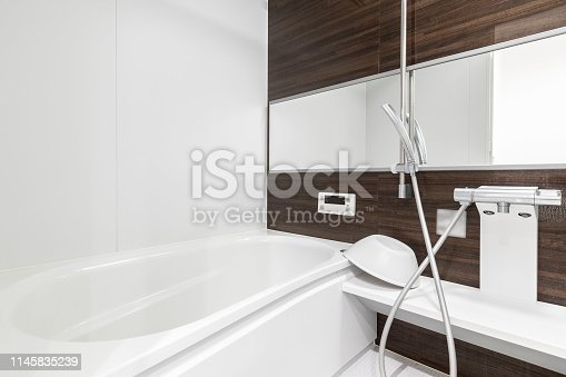 Large white bathtub in new modern bathroom