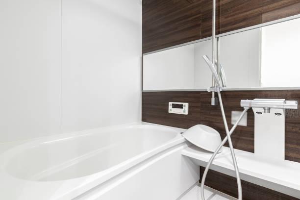 Large white bathtub in new modern bathroom stock photo