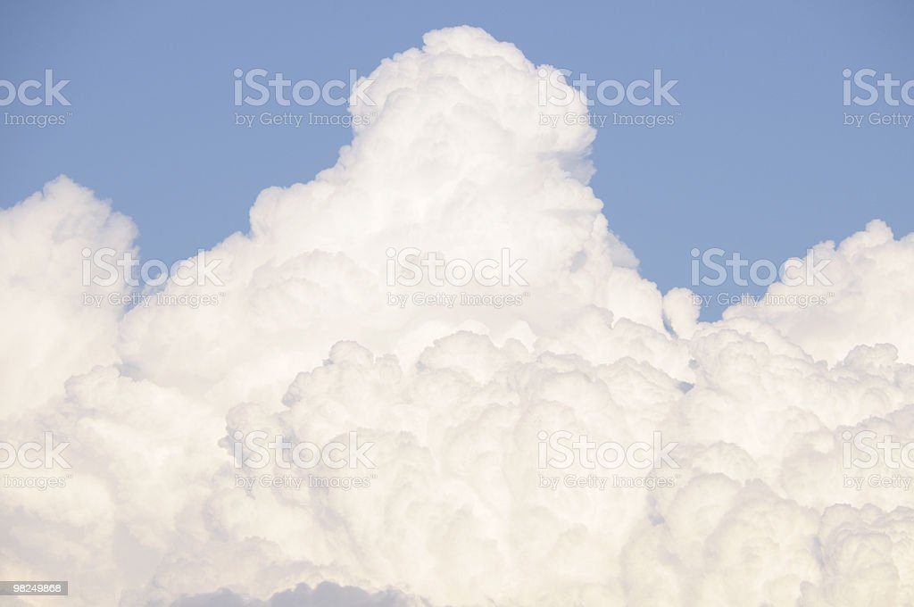 Large white fluffy clouds in a blue sky royalty-free stock photo