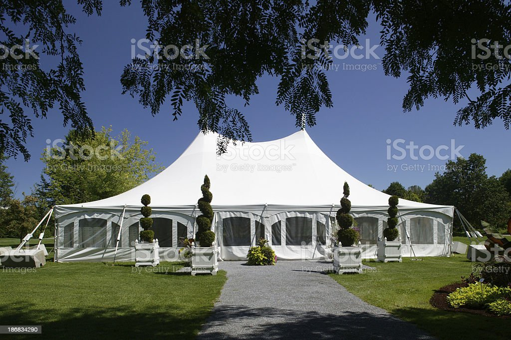 large white party canopy in the park stock photo