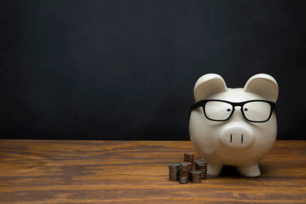 Large White Piggy Bank with Blank sign on Black Chalkboard Background This is a photograph of a large white Piggy Bank sitting on a desk a with a chalk drawing of a blank sign on Black Chalkboard Background. This image could relate to savings and retirement. 401k stock pictures, royalty-free photos & images