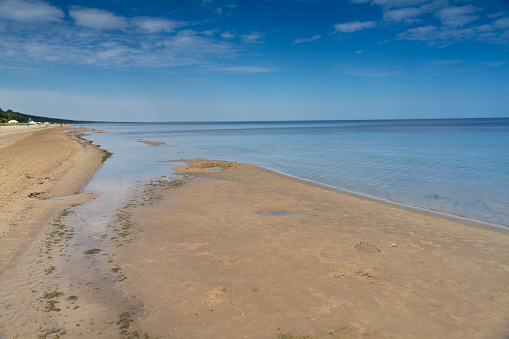 Large white sand beaches on the shores of the Baltic Sea in Jurmala, a resort town in Latvia, sandwiched between the Gulf of Riga (Baltic Sea) and the Lielupe River, about 25 kilometres west of Riga.