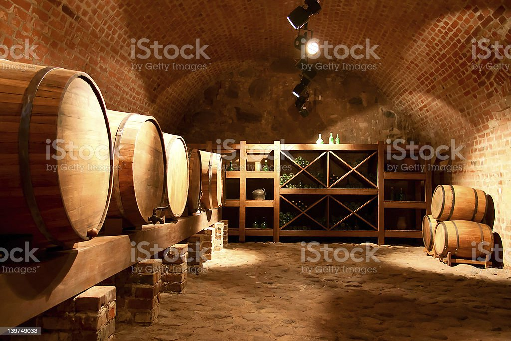 Large wine cellar with several wine barrels royalty-free stock photo