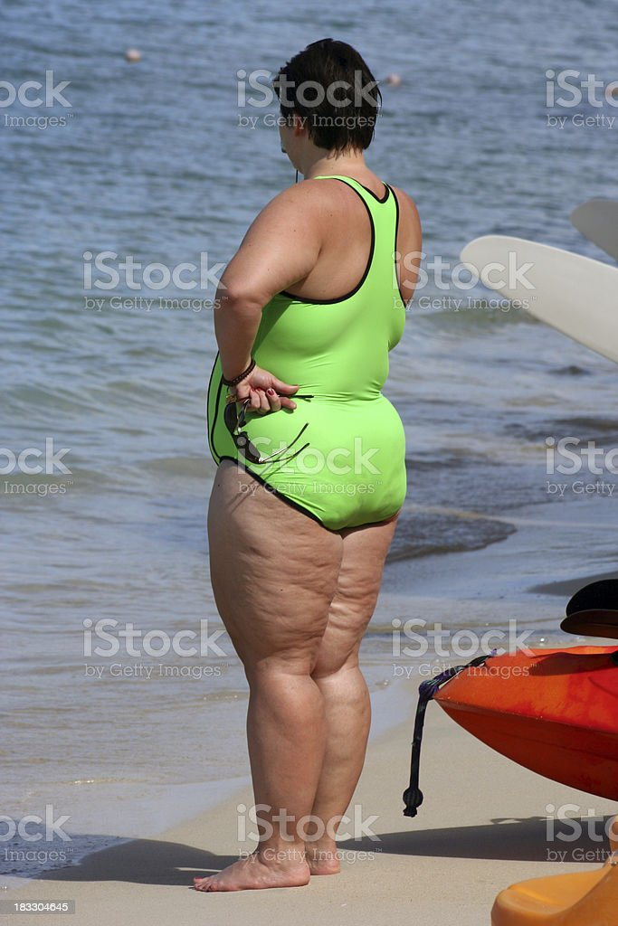 Large Woman on the Beach stock photo