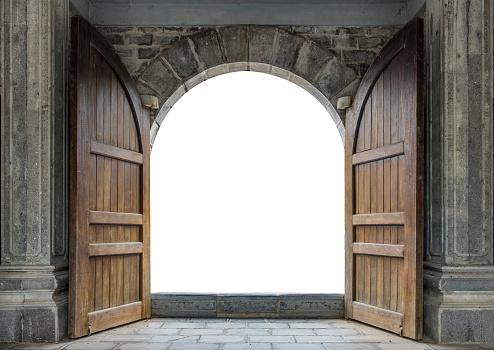 Large wooden door open in castle wall