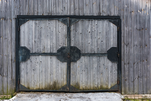 Large wooden gate in an iron frame.