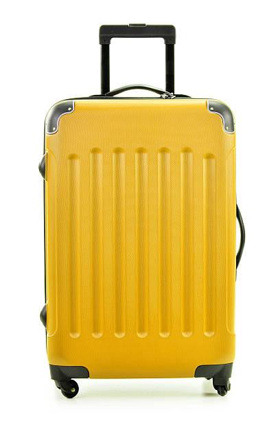 Large yellow polycarbonate suitcase isolated on white stock photo