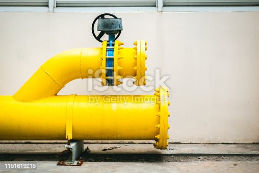 1132919452istockphoto Large yellow water pipe system. 1151619215
