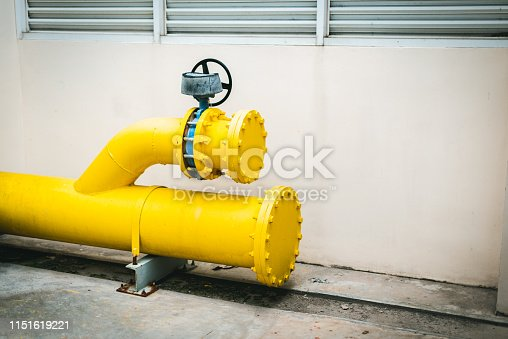 1132919452istockphoto Large yellow water pipe system. 1151619221