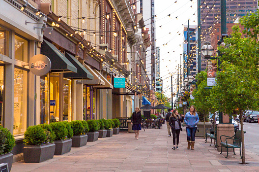 Denver, Colorado, USA - May 1, 2018:  Street scene along historic Larimer Square in downtown Denver with restaurants and shops in view.