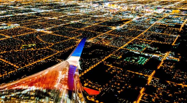 Las Vegas City lights from airplane at night stock photo
