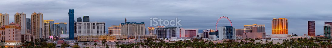 Evening shot of Las Vegas hotels and casinos with palm trees in the foreground