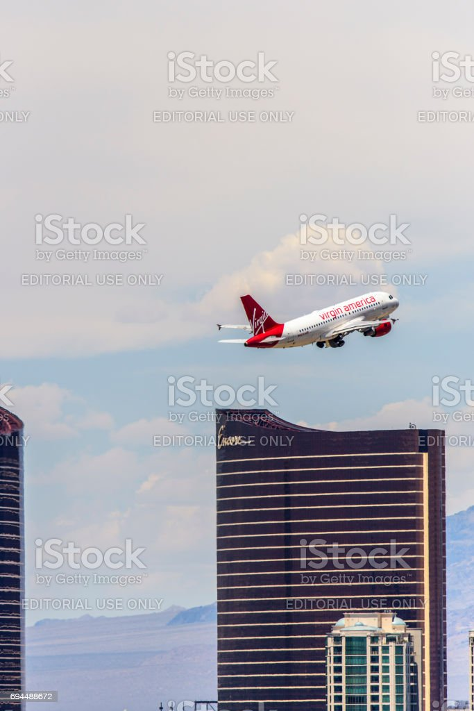 Las Vegas Hotel Casino Buildings with airplane taking off in the foreground stock photo