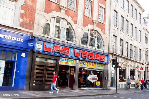London, United Kingdom - May 2, 2011: Las Vegas casino in Soho Area of London, United Kingdom. People passing by on the sidewalk.