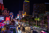 Las Vegas Nevada, USA. May 28, 2019. Las vegas strip aerial view at night. Illuminated buildings, colorful neon signs and ads, crowd and cars