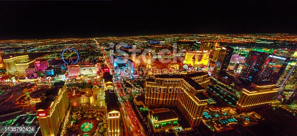 Las Vegas, Nevada, United States - August 18, 2018: aerial panorama of Las Vegas Strip by night. Scenic flight over High Roller, Caesars Palace, The Paris, Planet Hollywood, Bellagio Casino and Hotel