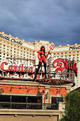 Las Vegas, Nevada, USA - July 1, 2015 : A devil girl statue stands on the top of Diablo's Cantina in front of the Monte Carlo in Las Vegas. About 40 million people visiting the city each year.